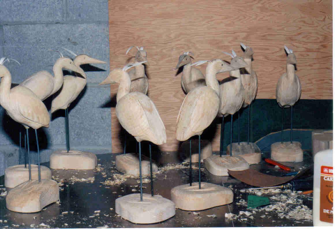 Flock of Herons underway by Bev Clark